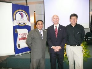 Dr. Switzer with two gentleman from a leadership session in Ecuador.