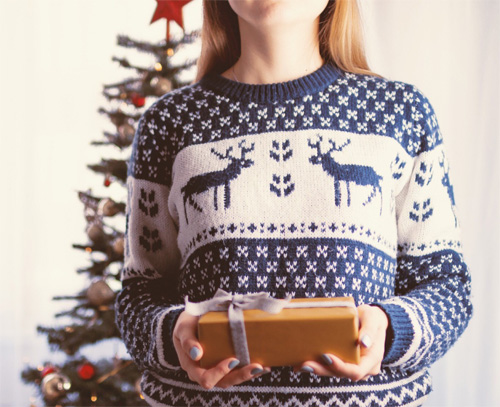Girl in sweater giving a gift of leadership development